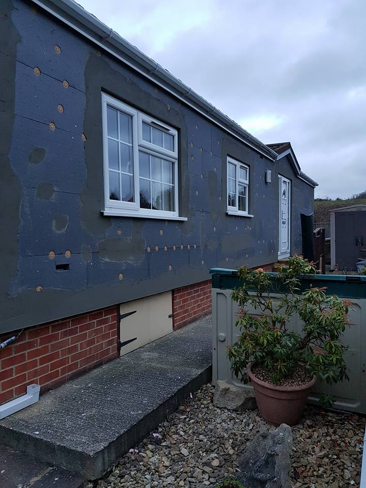 External park home wall insulation boarded