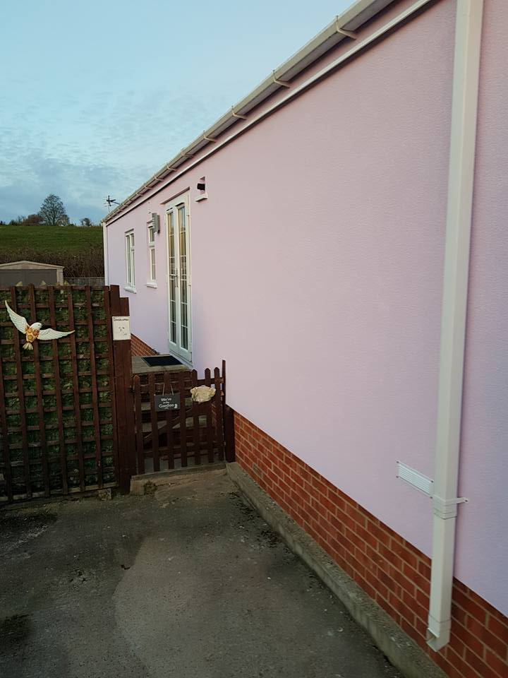 Pink mobile home External Wall Insulation